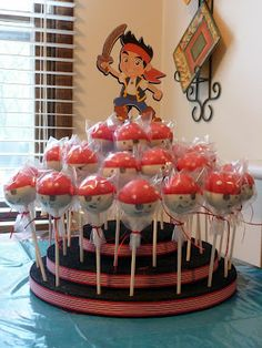 I made the cake pops, stand and the Jake figure. Pirate Party