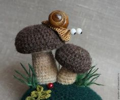 You'll love to make this gorgeous Crochet Snail Pattern and how seriously cute are they. We've included Crochet Toadstools too that you are guaranteed to love. How sweet is this Amigurumi Crochet Snail Pattern! Crochet Snail, Crochet Food, Crochet Animals, Crochet Crafts, Yarn Crafts, Crochet Projects, Irish Crochet, Knit Crochet, Tunisian Crochet