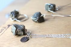 Raw Pyrite Necklace--- Beautiful energy for your Chakras, Inspiring CONFIDENCE when you speak, so you can freely express your TRUE self and succeed at manifesting your dreams. This Listing is for : 1 Genuine Raw Pyrite Necklace: YOU GET: 1 approx 1.5 inch Pyrite Natural gemstone in beautiful silver plated nickel-free lead-free wire wrap on a 17 Inch Chain ++++IF YOU WANT A FREE INITIAL CHARM LEAVE US A NOTE TO SELLER UPON CHECK OUT LETTING US KNOW THE TYPE OF CHARM AND THE INITIAL YOU…