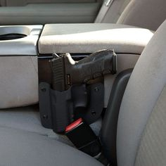 This simple but effective console holster allows you to have your pistol holstered right next to you in the center console of your vehicle for quick deployment. H&K, pistol Rifles, Pistol Holster, Ar15 Pistol, Weapon Storage, Cool Guns, Truck Accessories, Tacoma Accessories, Guns And Ammo, Tactical Gear