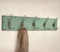 Everyone needs a place to hang their coat. This Rustic Wood Entryway Rack is the…