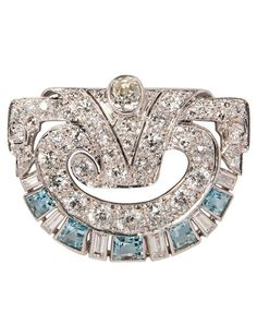 An Art Deco Platinum, Diamond, and Aquamarine Brooch. Bezel- and bead-set with baguette-, old European-, and single-cut diamonds, further set with step-cut aquamarines, length 1 1/4 in.