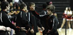 Geoffrey Alexander slapping hands with teammates after introductions at a home meet in the Comcast Center Wrestling Facility.    Maryland Athletics - University of Maryland Official Athletic Site @umterps