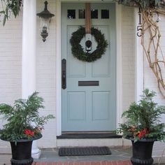 front door is BM's whythe blue - siding in light gray/brown - i love this combo