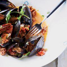 Mussels with Merguez Sausage Recipe on Food & Wine (richly seasoned lamb sausage) Shellfish Recipes, Shrimp Recipes, Wine Recipes, Food Network Recipes, Paleo Recipes, Cooking Recipes, Cooking Fish, Merguez Sausage Recipe, Sausage Recipes
