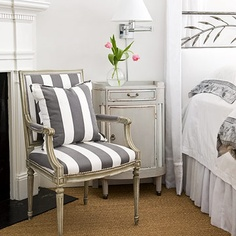 I like the crisp contrasts of the charcoal stripes against the soft gray walls and white bedding.
