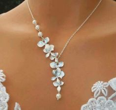 One sided silvery flower necklace-slight blue tint with pearl at bottom.