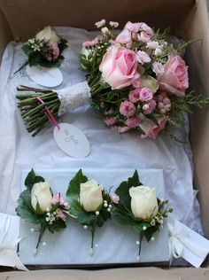 Bridal bouquet of pink sorbet roses and fairy roses with buttonholes.