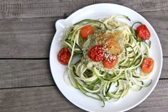 Zucchini Zughetti by bluebelle.nl ;-) : zucchini with a pesto made from white union, avocado, brazil nuts, chili, olive oil a pinch of salt en lots of lemon & herbs. YAMMM topped with some tomatoes. ENJOY.