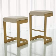 Attractive and useful contemporary barstools are made from sturdy antique brass mild steel and cushioned ivory leather seats. Available in bar or counter heights. Ivory leather Antique Brass Finish Foam, polyfill, synthetic webbing x x or x x