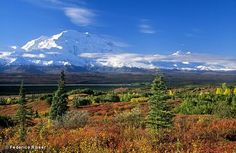 Mount Mckinley - Alaska - on one of the rare days you can see it - during the summer when there are all the tours up there - the hotels at the edge of Denali National Park will give you a wake up call if you request  - if the clouds clear and you can see the mountain top - in the summer it is daylight almost all night long