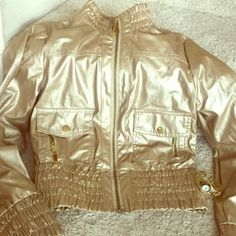 I just discovered this while shopping on Poshmark: Shiny gold jacket. Check it out! Price: $15 Size: XS, listed by youchic29