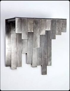 This is another example of an idea I had in my head and just needed to make it to see how it would look. I love the various shades of gray that steel comes in and thought showcasing those differences would look cool. And I think it does. It's a simple design that really lets the material shine – so to speak. #walldecor #metal #steel #gray #gradient #shinymetalobjects #riggodesign www.riggodesign.com