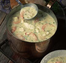 Seafood chowder in copper pot