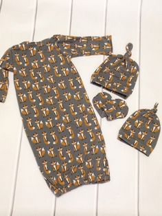 A personal favorite from my Etsy shop https://www.etsy.com/listing/471274932/fox-baby-gown-baby-gown-gift-set-coming
