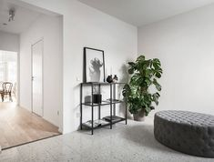 Urban townhouse with ground floor plot. At the top of the house there is a private roof terrace that creates a secluded roof garden. Monochrome Interior, Interior Design, Cactus Y Suculentas, Classic Elegance, Extra Seating, Danish Design, Terrazzo, Foot Rest, Ground Floor