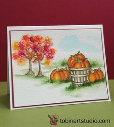 Art Impressions Watercolor Fall scene.  Handmade card with pumpkins, wood basket, trees, grass