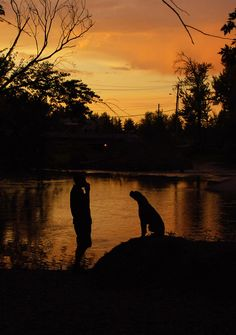 """This is named """"Piano Man's Best Friend"""". I was losing light fast and needed to run back to the car to change lenses. When I came back down to the river Kevin was playing piano man on his harmonica and Kody was howling. They ended up being the best shots of the evening."""