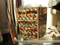 Woven Tin Wastebasket  This colorful basket by Hipcycle is made from scrap tin containers and can store plenty of items without taking up too much space. Similar design ideas include using magazines, plastic bags, T-shirts and newspaper.    Repurposing Household Items for Closet Organization : Rooms : Home & Garden Television