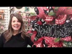 Anna shows how to make a beautiful Christmas wreath with a work wreath, mesh, ribbon, and a chalkboard sign.