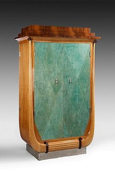 Art Deco dressing cabinet in sycamore and rosewood. Shagreen covered doors.  French, circa 1920.
