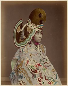 [Performer in Bugaku-style Costume]  Unknown Artist, Japanese   Date: 1880s Medium: Albumen silver print Classification: Photographs. his photograph of a woman in a bugaku-style costume was probably produced for the tourist trade. Bugaku, a traditional form of Japanese court theater that dates back to the first millenium, was performed only by men. The photographer's use of a female model suggests that he was concerned more with effect than with authenticity.