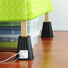 Raise your bed with lifts featuring USB and power outlets. | 37 Awesome Ways To Create The Dorm Room Of Your Dreams