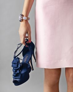 Punch up a lady-like dress in blush with ruffled navy heels    #polkadotdesign #bridalshower