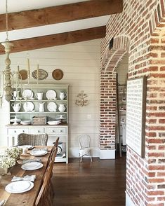 """I had been dreaming of interior brick walls ever since the first time I watched Steel Magnolias...MANY years ago! I thought Sally Fields' entire home was cozy perfection, and the brick walls in the kitchen, well, I knew I had to make it happen one day!  So it only took about 25 years, but Jeffrey helped me make the dream come true. I found three pallets of a new brick that looked old (I couldn't find enough actual old brick) and we spend several weekends cutting 5/8"""" thick faces off of each…"""
