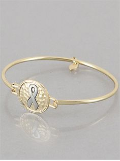 Support your cause with this delicate cancer ribbon bangle.