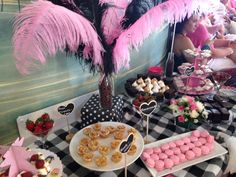 Sweet table with pink & black feathers