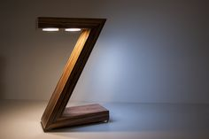 Zeta is a led table lamp made by wood - made in Italy unique pieces