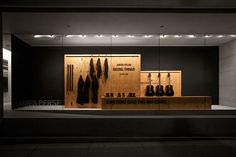 James Perse, Jakob Dylan Storefront | Oriented Strand Board used in visual merchandising and window display design