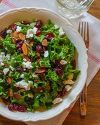 A quick, easy recipe for a hearty kale salad with cranberries, almonds and goat cheese—ready in 15 minutes.