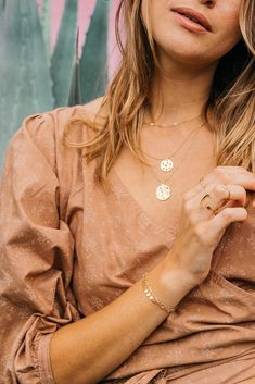 Layer on our coin necklace with a thin choker and you've got instant style! Shown here, our queen bee necklace, star gazer necklace and lace choker. By Amanda Deer Jewelry.