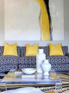 ..more yellow....pillows, adding ways to spread more yellow...but not too much.striped rug with the chocolate and yellow in another room like kitchen, or mud room?