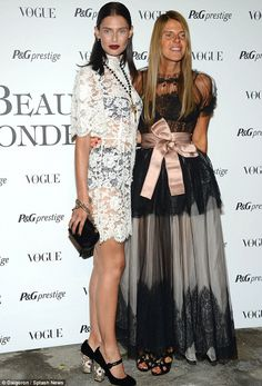 Sept. 2013 - Fashionable: Bianca Balti posed with Vogue Japan's Anna Dello Russo, who added a pink sash to her lacy black and grey number.