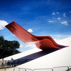 The Craziest Architecture You Have  To See Before You Die #refinery29  http://www.refinery29.com/best-architecture-instagram-pictures#slide-8  Ibirapuera Auditorium, São Paulo, Brazil  An eye-catching crimson flank — in the shape of a burning flame — extends from the all-white body of this musical venue. The striking landmark stemmed from the vision of legendary architect Oscar Niemeyer.