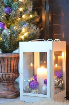 Easy Holiday DIY: Fill a lantern with ornaments and LED candles. Quick and stylish holiday decor!