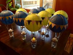 Let's talk about creative and fun DIY baby shower table top centerpiece decoration ideas. They created a hot air balloon from paper lanterns with mason jars and tea light candles!