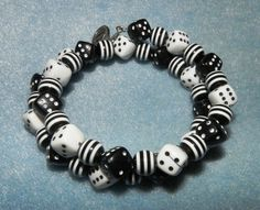 Black and White Dice and swirl beads memory bracelet, $10