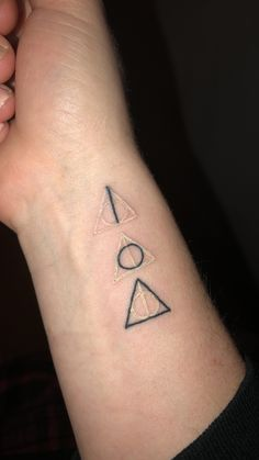 Harry Potter Deathly Hallows Tattoo With White And Black Ink. Showing The  Elder Wand,