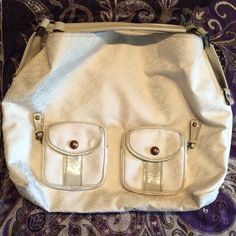 Oversized cream BCBGIRLS hobo bag Roomy tote perfect for classes, work and travel! Two front zipper pouch pockets with button slip pocket in front (see last picture). Button top closure with very roomy interior with a zipper pocket and two pockets. Interior is in great like new condition; exterior has light stains from use but overall great condition! Tote is multipurpose and has room for everything! BCBGirls Bags Hobos