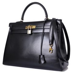Hermes Box Calf Kelly 35 Retourne Gold Hardware Black Tote Bag. Get one of the hottest styles of the season! The Hermes Box Calf Kelly 35 Retourne Gold Hardware Black Tote Bag is a top 10 member favorite on Tradesy. Save on yours before they're sold out!