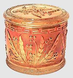 """*WILD BERRY~Little is known about this pattern. It's one of the few powder jars found in Carnival Glass. The maker is not known, but collectors speculate Westmoreland or US Glass. Found mostly in marigold but also reported in blue opal and moonstone. In 2004, an example marked as souvenir of Edinburg N.Y. sold for $120. In 2005, one lettered with """"Henderson Harbor, NY"""" sold for $300."""