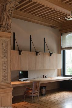 Light wooden workspace in a wonderful architectural detailed interior.