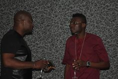 TALKE Tv Interview Host, Femi Ipadeola and Co-owner Latitude Lounge, Morakinyo Tytbones enjoy a drink after the Interview