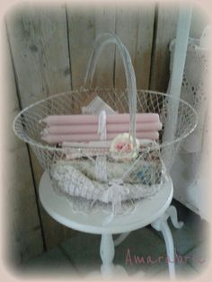 Brocante ~ Lace, old book and candles in wired basket