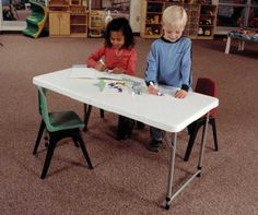 Lifetime Adjustable Leg Table - 4428 White 4 foot Fold-in-Half Folding Table. This picture shows two kids coloring at the table.