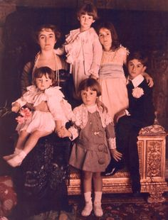 Luchino Visconti and his family, Cernobbio, circa 1912.  Notice how the photographer asked each member to hold each other, thus forming a circle; beautiful !